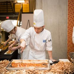 student chefs at a buffet