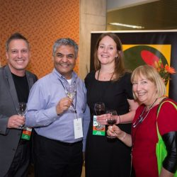 four people laughing during the event reception