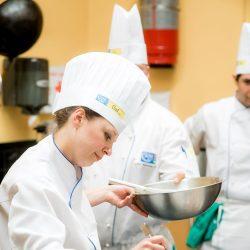 a student plating a dessert