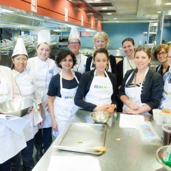 a group of people in the kitchen at the ambition nutrition symposium