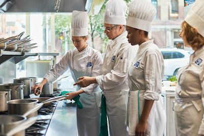chefs cooking with a teacher